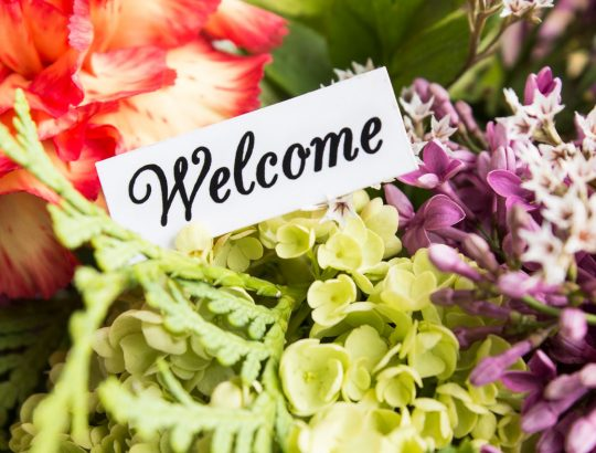 Welcome Card with Bouquet of Flowers.